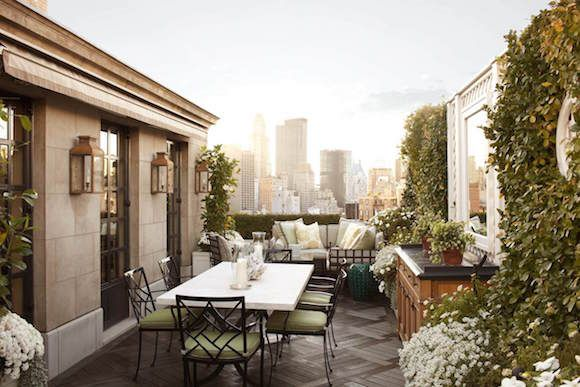 Brian J. McCarthy designed this Manhattan terrace to be casual and accessible. The large French wall lanterns in a bronze finish were from Charles Edwards, and the outdoor furniture was from Janus et Cie and Munder Skiles. Pinned from 1stDibs