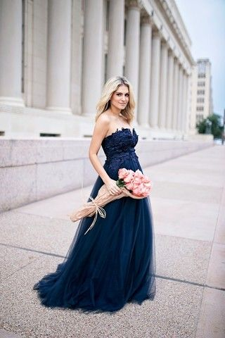 Behold this gorgeous navy ball gown - an opulent stunner that accessorizes best with attention and adoration! A strapless bodice decorated with dimensional lace accents precedes the full, flowing tulle skirt of this luxurious dress, earning its spot as the sight of the century.