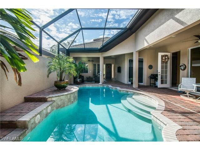 Single Family - ESTERO, FL This stunning Valencia courtyard model is a must see.   Enjoy the privacy of your pool in the courtyard with a cabana located steps away. There is an additional rear screened lanai for relaxing while viewing the long lake. The main home boasts a master suite and  guest bedroom with their own bath located at opposite ends of the home. There is also a  separate cabana with bedroom  & bath (3 bed / 3 bath).   The  kitchen is open to the great room and overlooks the…