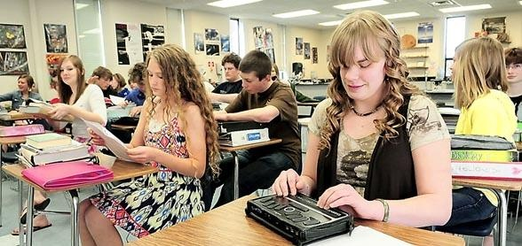 Brainerd Dispatch/ Steve Kohls-Katelyn Beckman (right) took notes on her BrailleNote tablet in biology class Friday on the South Campus of Brainerd High School. Beckman, who is blind, traveled to Washington recently in a select group of 24 blind or visually impaired students.