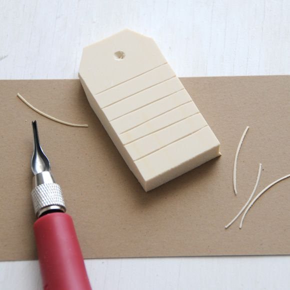 Simple tag stamp - homemade from an eraser... this is a great idea, however not like the picture. You would leave only an outline, and Raised lines not indented. This pic of a stamp is reversed unless you were only using a light colored ink...