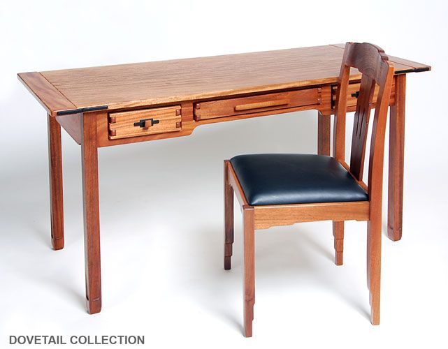 This Greene and Greene-style writing desk features curly African mahogany and ebony. The handmade drawers have proud finger joints and the tabletop features classic breadboard ends and carved ebony accents.