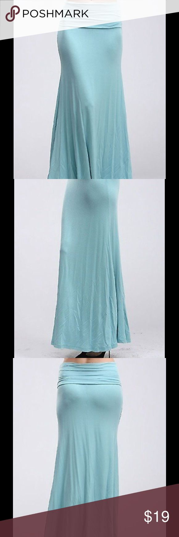 Full Length Maxi Skirt in Mint Full length solid skirt with an overlapped waist and asymmetrical hem.  Perfect color for the season and so trendy for the fall.  95% Rayon 5% Spandex Skirts Maxi