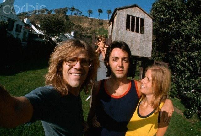 Photographer Henry Diltz with Linda and Paul at the home they had rented on the Santa Monica Beach summer of 71 - Mary and Heather McCartney are on the slide in the background.