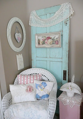 love the aqua door draped in lace ... and the empty framed heart ... and the wicker chair and pillows ... and ...