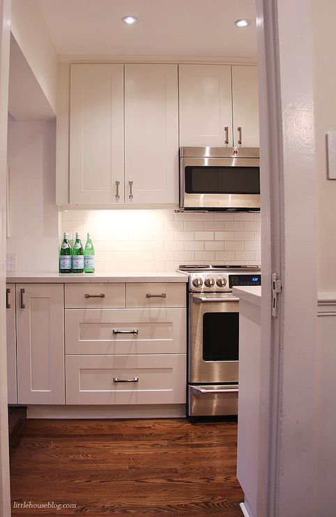 Lovely White Kitchen With Ikea Adel Cabinet Doors Pairing With Modern  Polished Nickel Hardware.