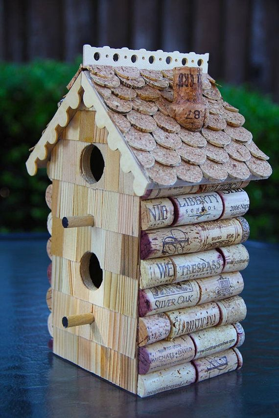 A unique Carefully Corked birdhouse. All my birdhouses are decorated with recycled wine corks. All wines were consumed humanely in California. This is a straightforward birdhouse shape, made more interesting by the shakes on the front and the gingerbread trim. It is unstained for a light, natural finish, then sealed with an outdoor sealant to extend its lifetime. A unique addition to a deck, patio, balcony, etc. This would be a cool gift for anyone who appreciates wine, nature, or both…