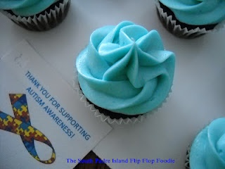 "Light It Up Blue Autism Awareness Cupcakes - with a great ""crusting"" frosting.  Easy to transport - if you are careful, none of the piping gets compressed when covered with plastic wrap!"