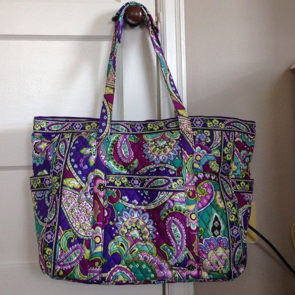 Vera Bradley Get Carried Away Tote Soft, quilted bag and straps; Six interior slip pockets and two plastic lined pockets; Airline carry on compliant. Machine wash cool, gentle cycle Vera Bradley Bags Totes