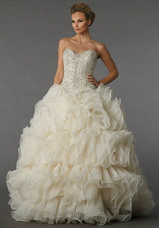 This ball gown features a sweetheart neckline with a natural waist in chiffon and beaded embroidery. It has a chapel train.
