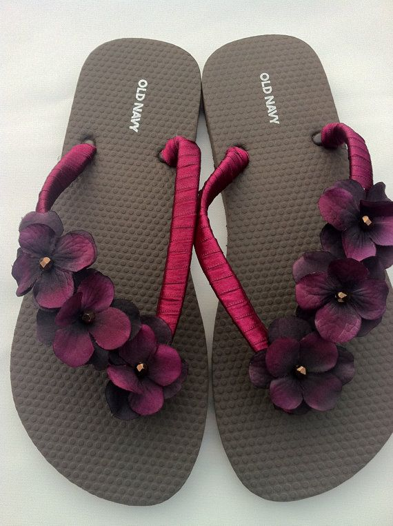 ribbon wrapped, flower applied flip flops.  cute!