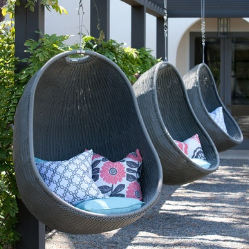 HELP DAD RELAX IN A COVE CHAIR - Part of Outback Company's Urban Balance collection, the Cove Chair is the ultimate in weightless design. It features an aluminum frame and an all-weather wicker lining. Fabricated with the highest manufacturing standards, this chair is as welcomed inside as it outside—and it comes with hanging hardware and five durable Sunbrella pillows. Curl up and relax in this unique hanging chair.