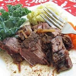 Browned chuck roast is slow cooked for 8 to 10 hours along with potatoes, carrots, onion, celery, and dehydrated onion soup mix.