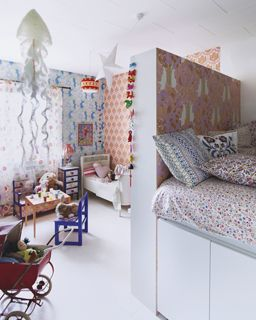 room divider from billy bookcases definitely an option if sharing a room becomes more permanent for us plus i like all the underbed storage