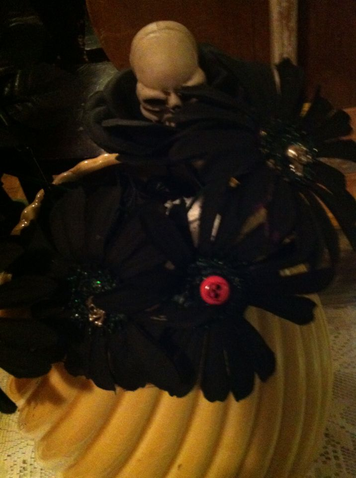 A closer look of my DIY gothic flowers. I painted them black, added glitter paint to center, than placed a stud earring with skull on it in the center. I added some Halloween roses I had left. In love with the way this turned out!!!
