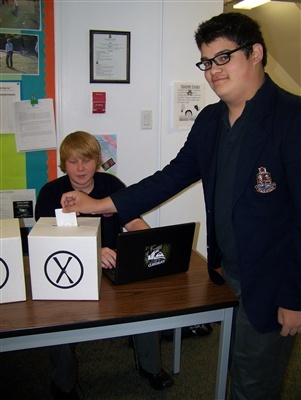 At MacLachlan College, Ms. Woodward's grade 5 class organized a polling station in room #209 for the Junior Division and Mr. Ferguson's grade 10 Civics class conducted their election on the third floor.