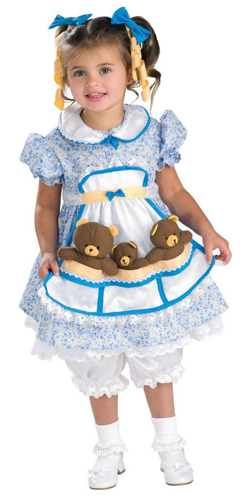 #883643 She'll join the 3 bears this Halloween as Goldilocks. The Goldilocks Costume includes a blue and white floral dress with attached apron and pantaloons. The blue and yellow hair bows with ribbo