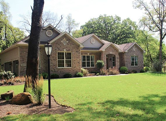 Custom Ranch Home Nestled On A Scenic Wooded Lot