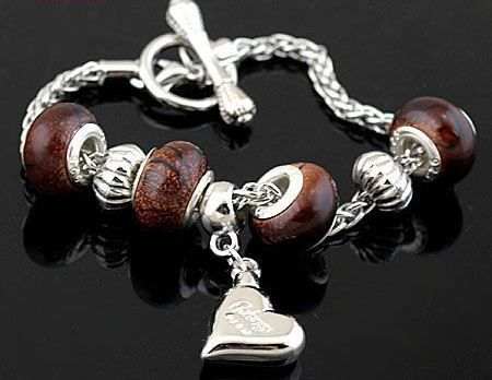 SC116 Handmade silver charm bracelet, on snake chain, with dragon vein charms and brown porcelain European beads. Normally retails for around $25 each - my selling price (including postage within Australia) is $15.00 each... Please feel free to contact me if your require price for postage overseas…