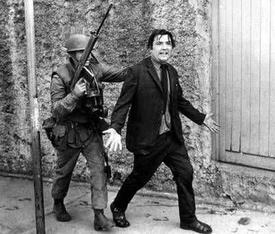 John Hume is detained by soldiers during a civil rights protest in Londonderry in August 1971.