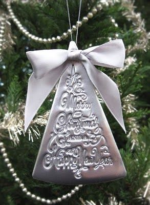 Silver sprayed and stamped clay ornament.