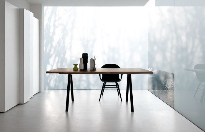 A sleek and functional office table that has been cleverly designed, with a variety of modifications available to truly make it your own.