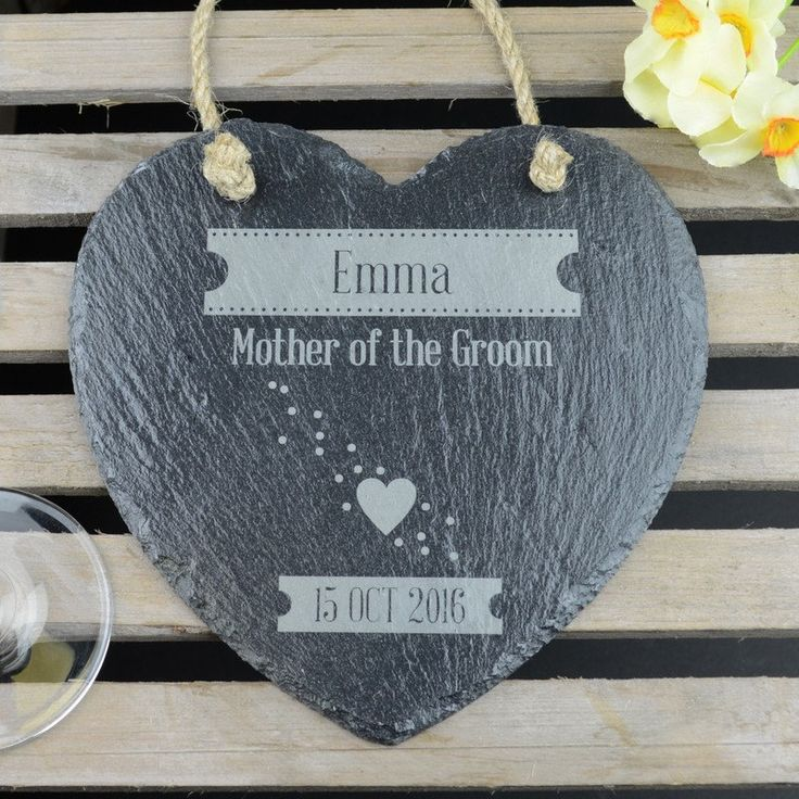 The Mother of the Groom Thank You Wedding Heart is a wonderful keepsake gift to show your appreciation for all the love and support you have received from the mother of the groom in the run up to your wedding day.  This beautiful black slate gift will be personalised with the mother of the groom's name and the happy couple's wedding date. A cute flourish of hearts finishes of this hanging heart decoration in style.  The stylish natural slate heart is supplied with a coordinating rustic jute…