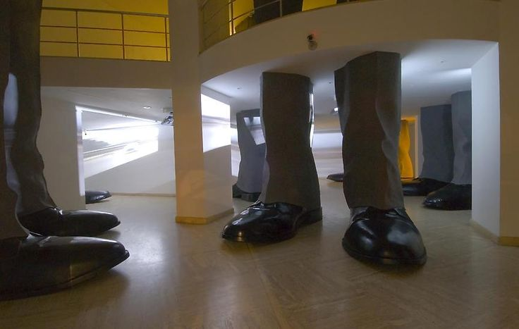 Hale Tenger, Lahavle, 2007, Site-specific installation, Fiberglass cast legs, 6-channel video and audio, music by Serdar Ateser, Dimensions variable