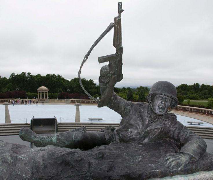 """National D-Day Memorial set to mark 70th anniversary of WWII Normandy landings. The top of Jim Brothers' sculpture, """"Scaling the Wall"""", at National D-Day Memorial in Bedford, Va. - Veterans - Stripes"""