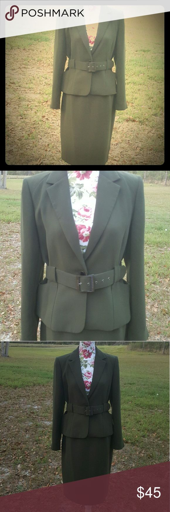 Like new Calvin Klein suit size 10 Sophisticated  and gorgeous 2 piece suit by Calvin Klein in hunter green color in size 10. My mom wore it once to a wedding.  Like new condition. Calvin Klein Dresses
