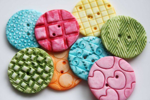 Handmade polymer buttons - maybe you could make some to go on your flowers!