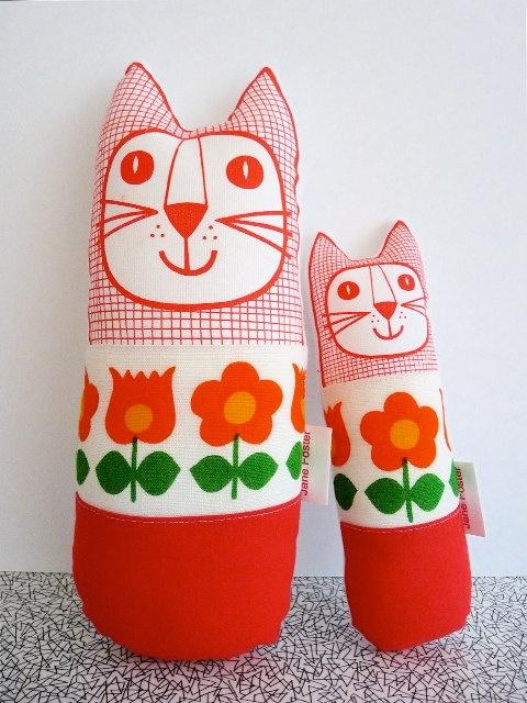@nicci horner horner horner Pair of Scandinavian 70s fabric handmade cat toys plush softie mum and baby retro. $39.00, via Etsy.