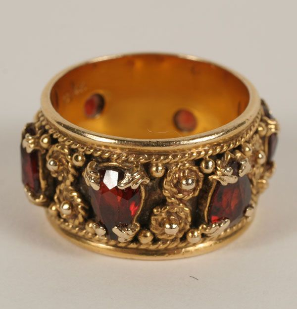 Gold marked 14K Edwardian style ring band, fancy prong set with 6 marquis garnets in a rotating pattern, with filigree work in between. 11mm shank. Size 7 1/4. 9.5 grams.