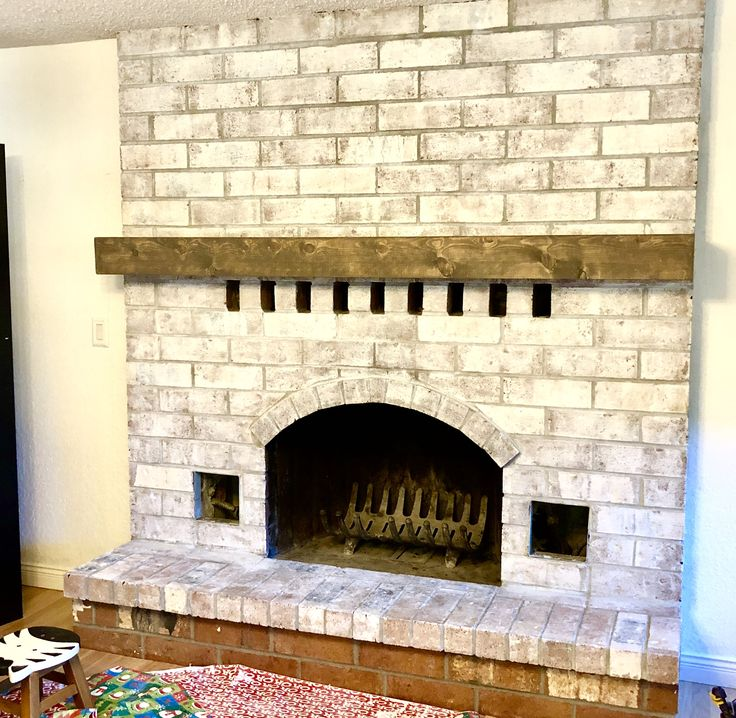Stain is the Briarsmoke color by  Varathane.  Added a floating shelf beam as a fireplace mantel.  Solid installation over solid brick.  The dark wood looks amazing over her whitewashed finishing! Just in time to hang up the Christmas stockings