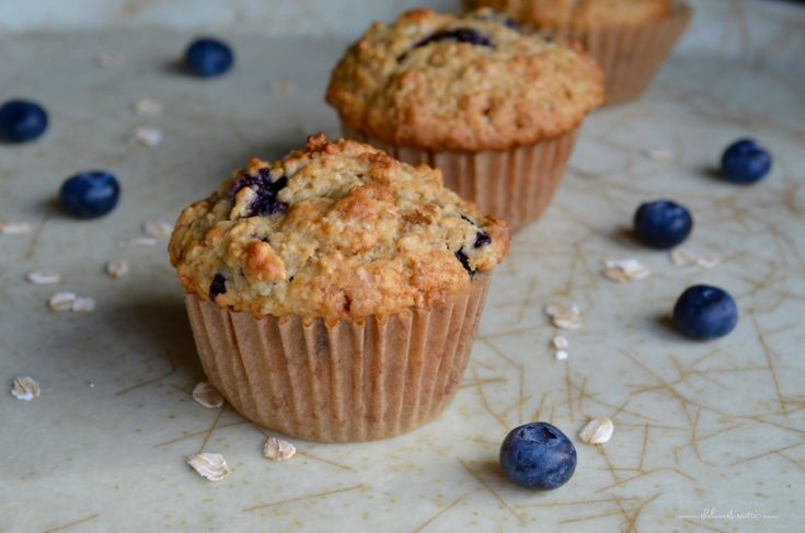 A few Healthy Blueberry Oat Muffins in a row.