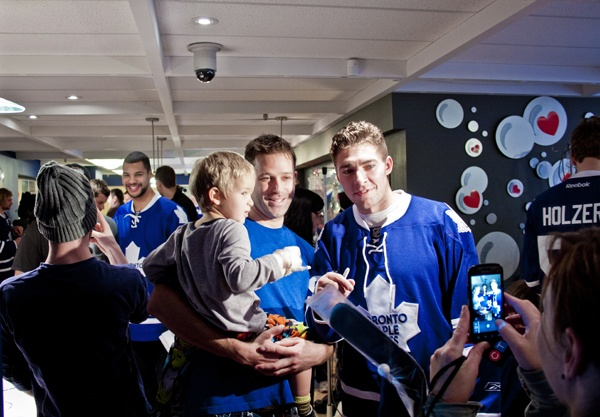 Joffrey Lupul poses for a photo with two Leafs fans.