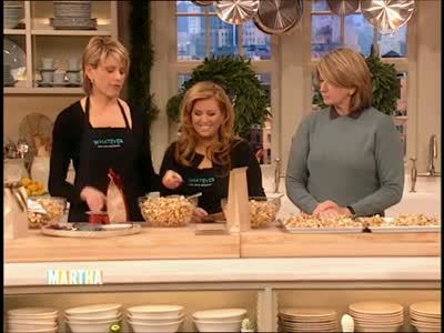 Martha Stewart and guest Alexis Stewart and Jennifer Koppelman Hutt finish baked caramel almond popcorn for Christmas.