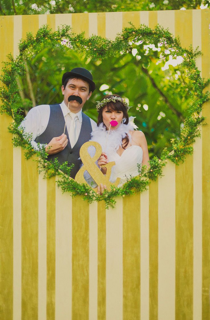 DIY whimsical wedding in Hawaii with photo booth backdrops heart yellow stripes