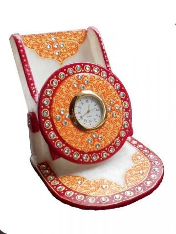Marble Mobile Stand with Watch is a master piece in marble. It distinguished a piece of art to enhance the beauty of your interiors and add brilliance to your home and office decor. A perfect gift for any occasion.