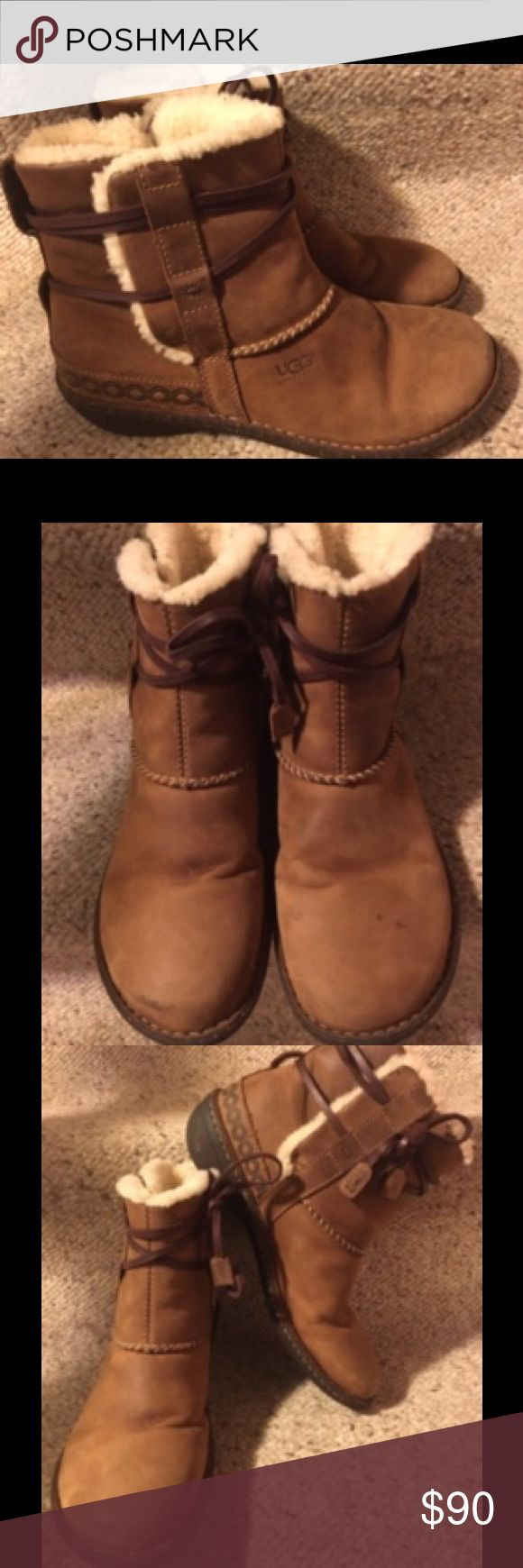 UGG Tan Leather Boots Rare tan leather waterproof boots with leather straps that goes around the ankles, wool lining with sturdy rubber soles. Size 10. I wore them a couple time to try to break them in since they were a little too small for me but a size 11 was not available. Small spots on the left front. UGG Shoes Ankle Boots & Booties