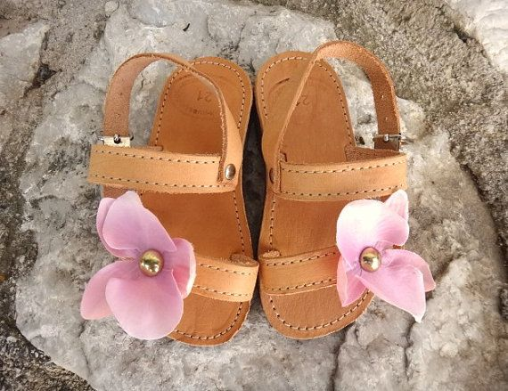 Baby pink fabric orchid with applied brass studs in gold color. Cute sandals for your baby or girl made by high quality Greek handmade leather. These