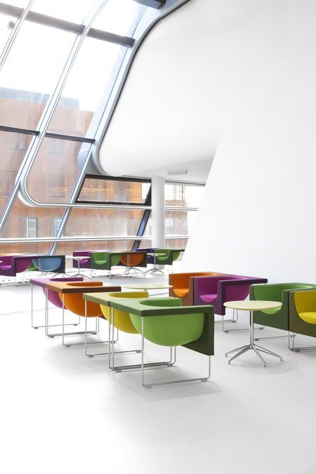 The Vienna University of Economics and Business, has the Nube Chair in their University library. Designed by Jesús and Jon Gasca for Stua, the Nube Chair is similar to Hadid's architecture in its play of straight and fluid lines.