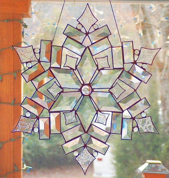 Stained Glass in snowflake design..imagining prisms of light through this...stunning!