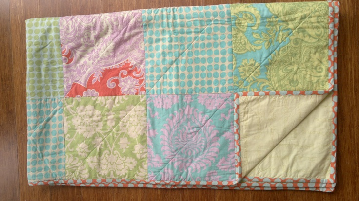 Family Quilt I made big enough for us all to snuggle under. Amy Butler on the front and Moda Simplicity on the back