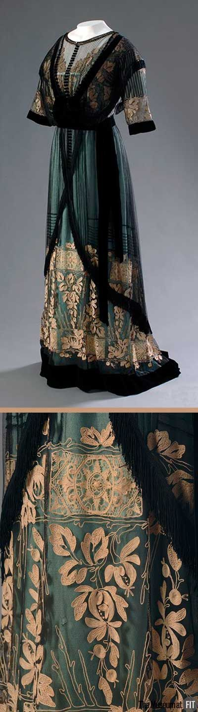 Dress, Mme. Percy, England, ca. 1910. Aqua silk satin with cream embroidery, net, and black velvet. In the early 20th century, cultivated women regarded pastels and muted shades as refined and