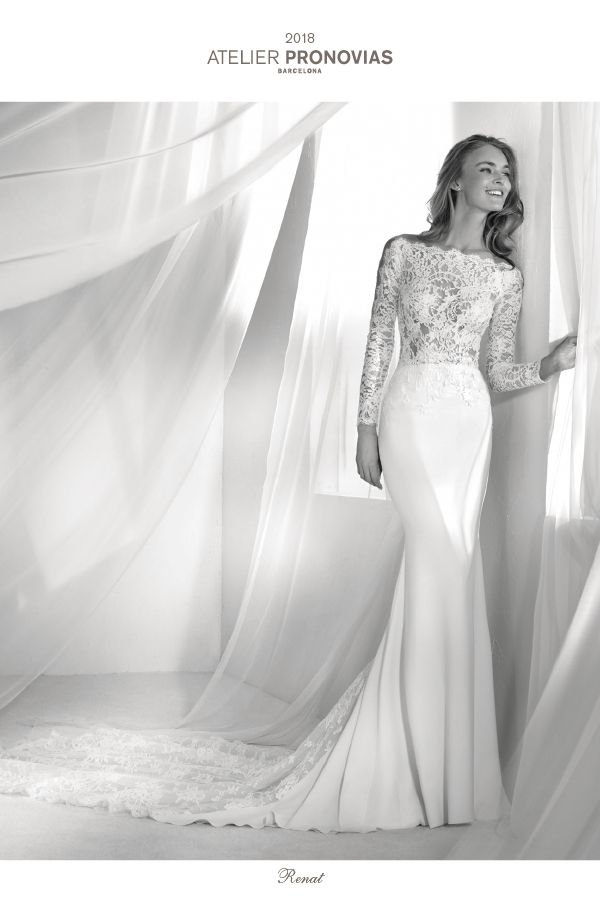 Once again, crepe and lace demonstrate their elegance and sensual power of attraction. This low waist mermaid wedding dress plays with a two-piece effect in the front. A long-sleeve, French lace bodice merges with a crepe skirt that accentuates the silhouette. The back, meanwhile, holds a surprise that will leave you speechless. A design with illusions on the back that descend down the skirt to blend in with the train.