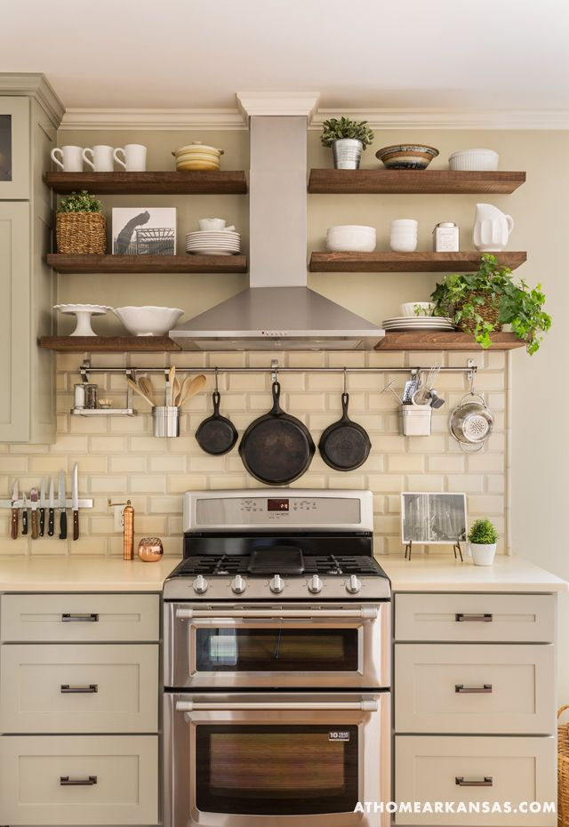 Love the shelves, plants, and cast iron skillets hanging.