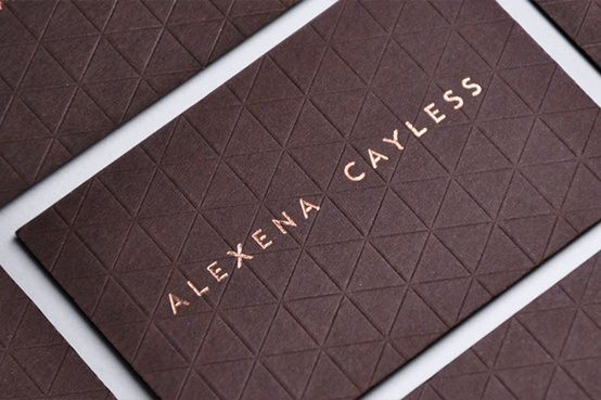 Alexena Cayles business card with blind embossed geometric detail and copper block foil print finish.
