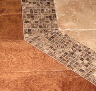 Use smaller tile as a transitional border between tile and hardwood floors.  Love this idea...would use a different style of tile for transition though!