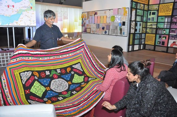 Showing a beautiful godhdi to designers..done by Muttvas  The Mutvas from the Banni region of Kutch are among the most prolific when it comes to styles of embroidery. They had migrated from Sindh many centuries ago most likely in search of fodder for their cattle. Some of the most beautiful crafts of the Mutvas get created around wedding. From around when a girl is 8 to 9 years old, till the age of 21 or 22, she embroiders 7 kanjeris ( blouses), 21 Godhdis ( quilts) and 2 covers for…